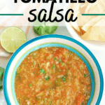 a blue and white bowl filled with tomatillo and tomato salsa, next to a bowl of tortilla chips