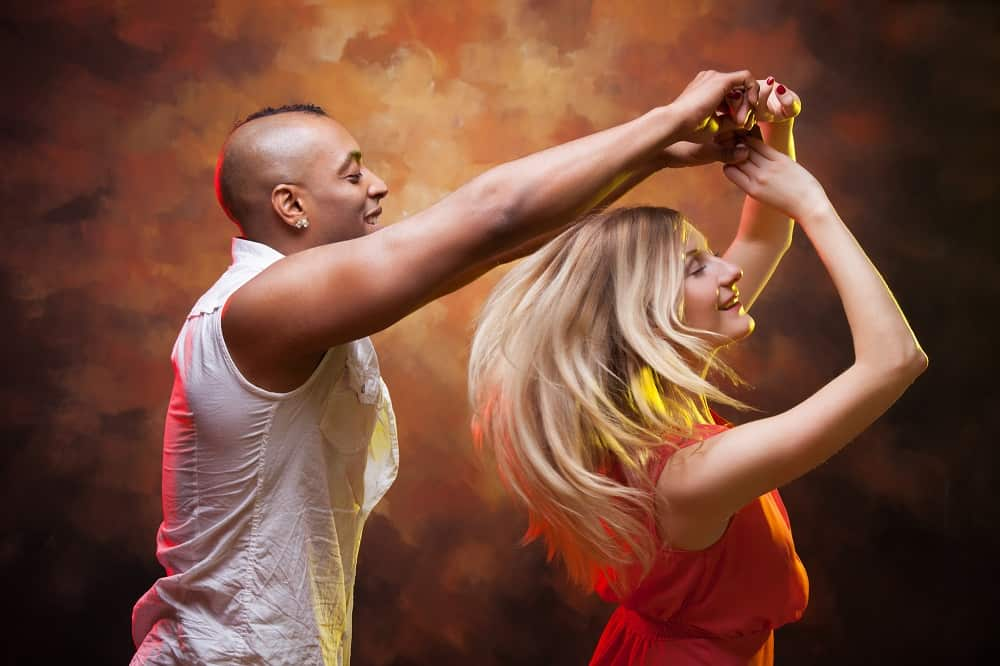 a couple doing salsa dancing together on a date