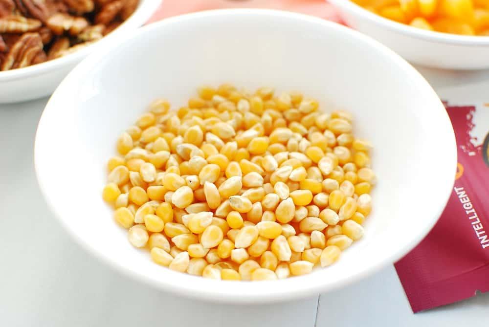 a bowl of unpopped popcorn kernels