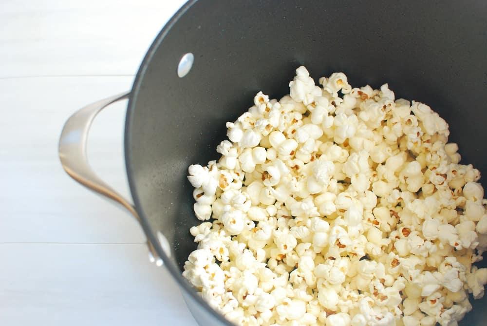 a pot full of popped popcorn