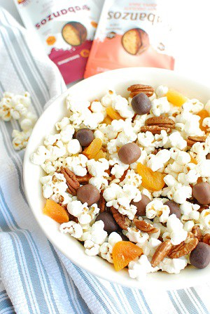 a bowl of popcorn trail mix