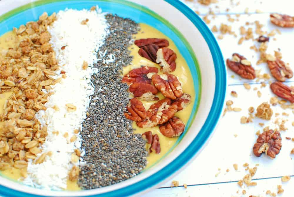 a close up of the chia seeds and pecans on top of a smoothie bowl