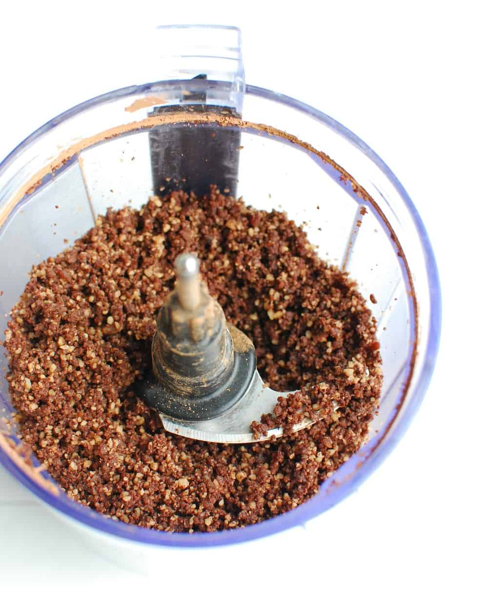 dates, nuts, and cocoa powder that has been processed together in a food processor