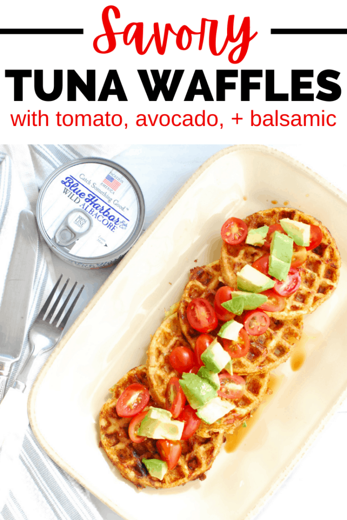 four tuna waffles on a plate topped with tomato and avocado