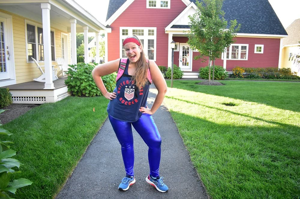 a woman dressed in patriotic running gear wearing a weighted running vest