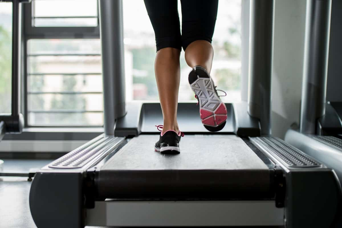a woman's legs photographed during a HIIT treadmill workout