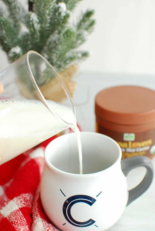 pouring hot milk into a mug