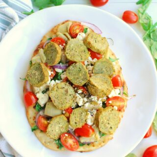 a Mediterranean flatbread topped with veggies and turkey meatballs