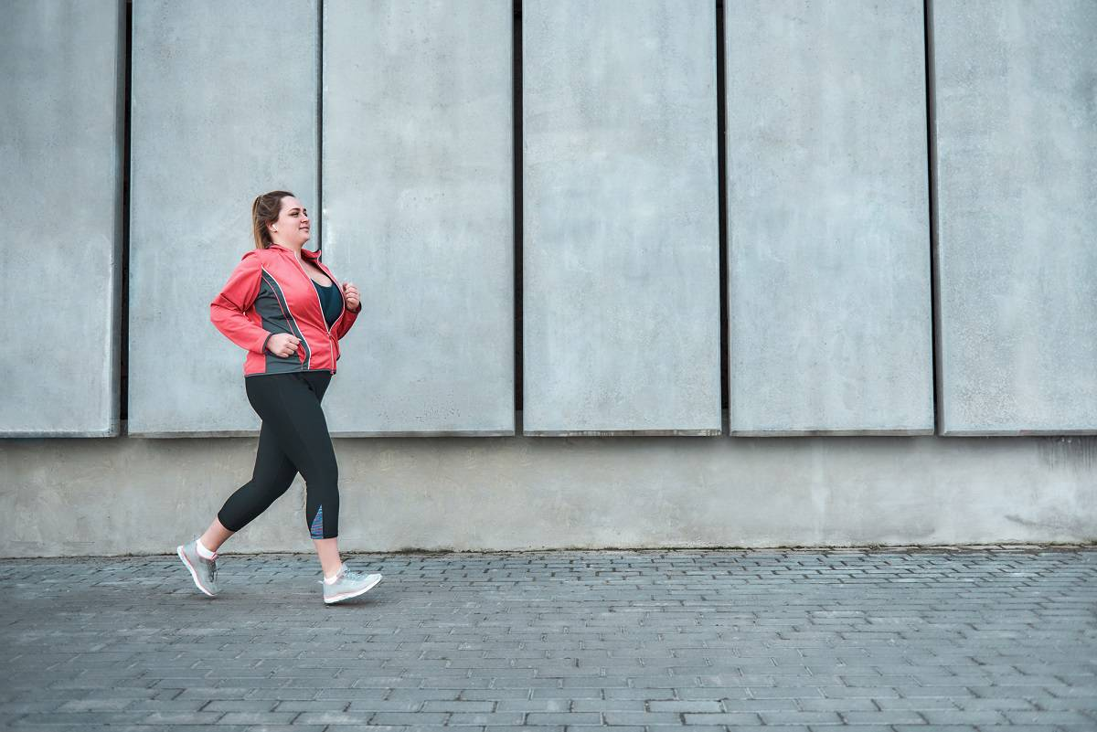 a female beginner jogger running outside