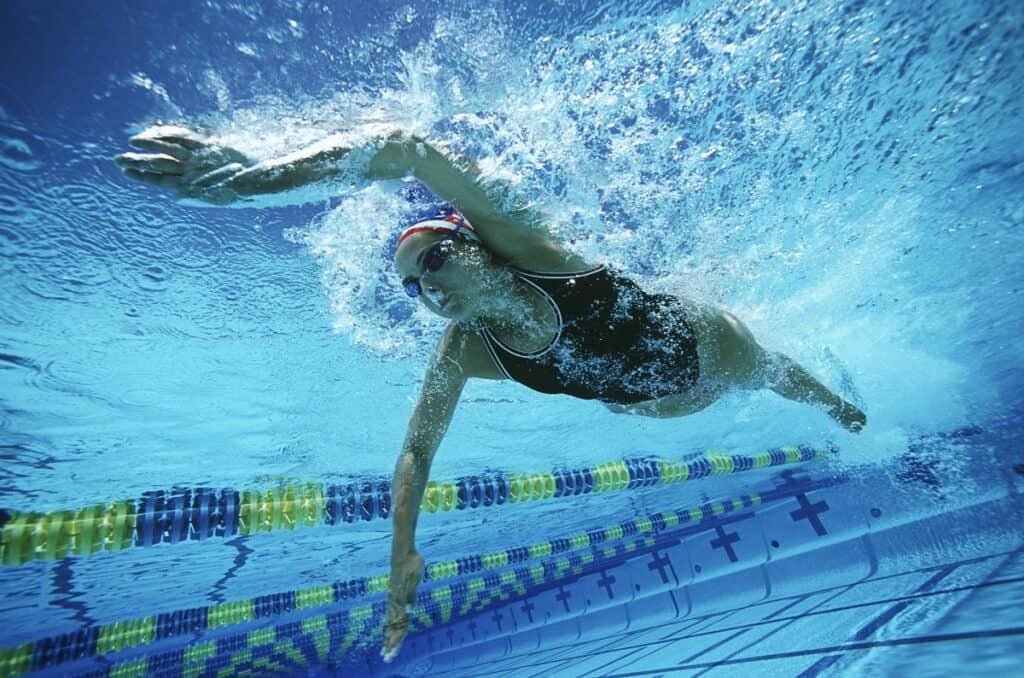 a female athlete swimming in a pool