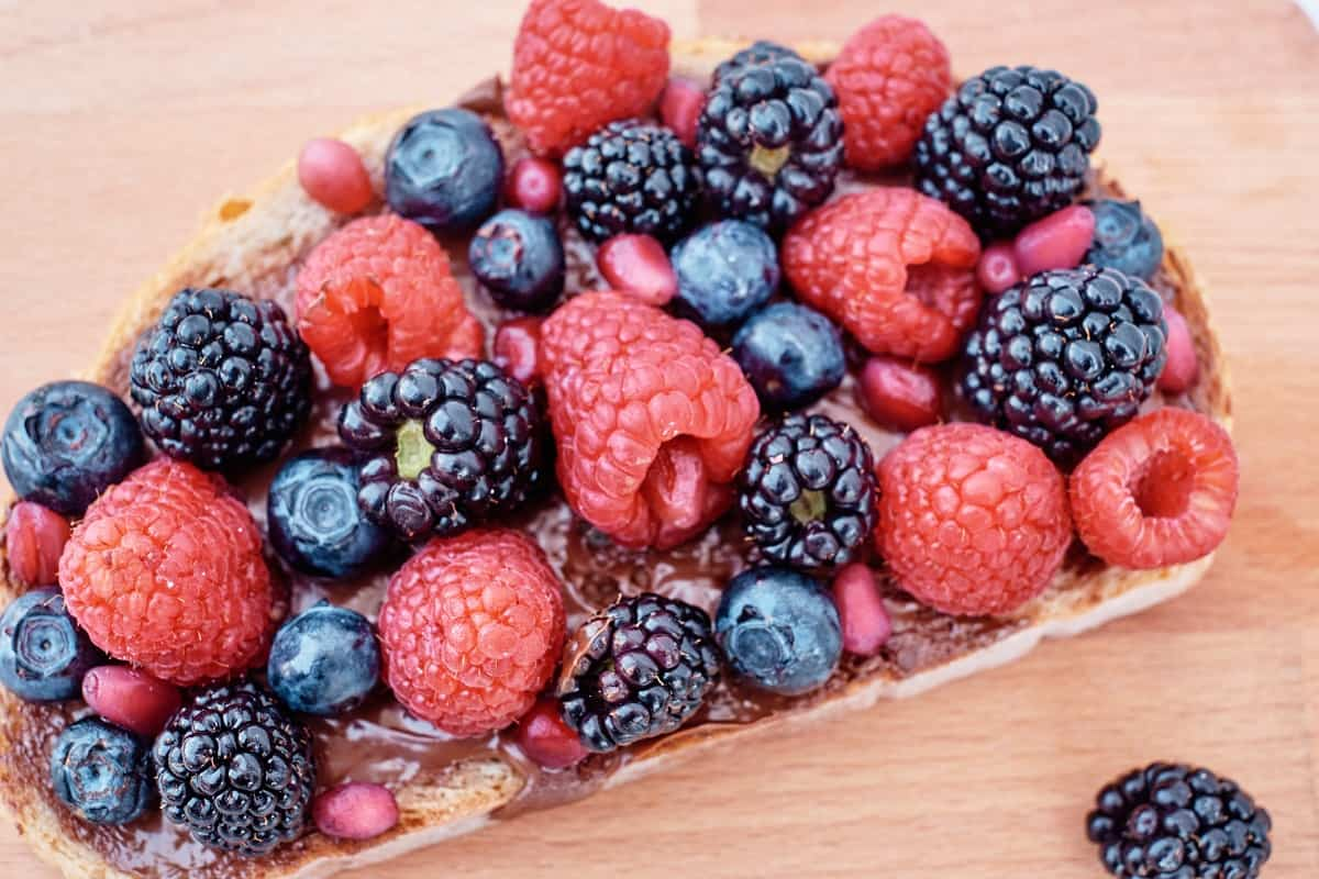 a slice of toast with chocolate nut butter and berries