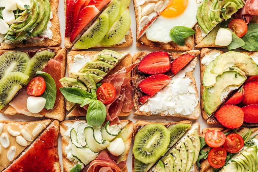 slices of toast with healthy toppings like strawberries and nut butter or salmon