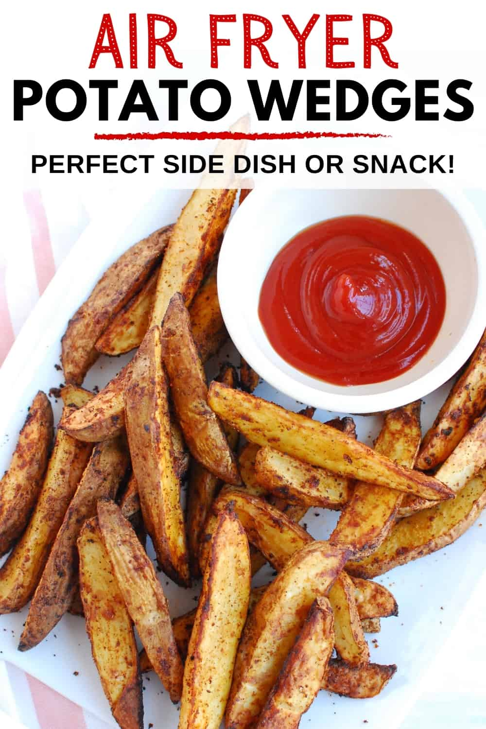 An overhead shot of air fryer potato wedges on a white plate with a small bowl of ketchup.