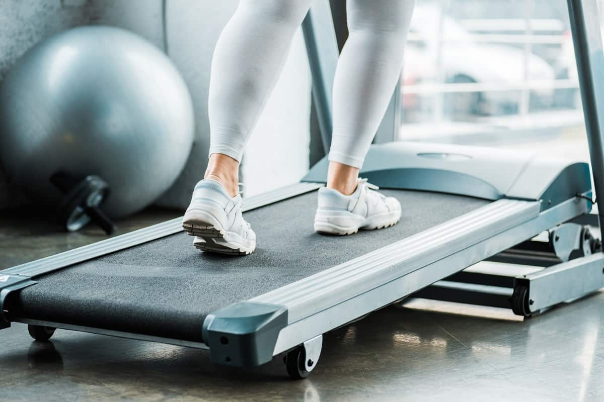 a woman's legs on the treadmill.