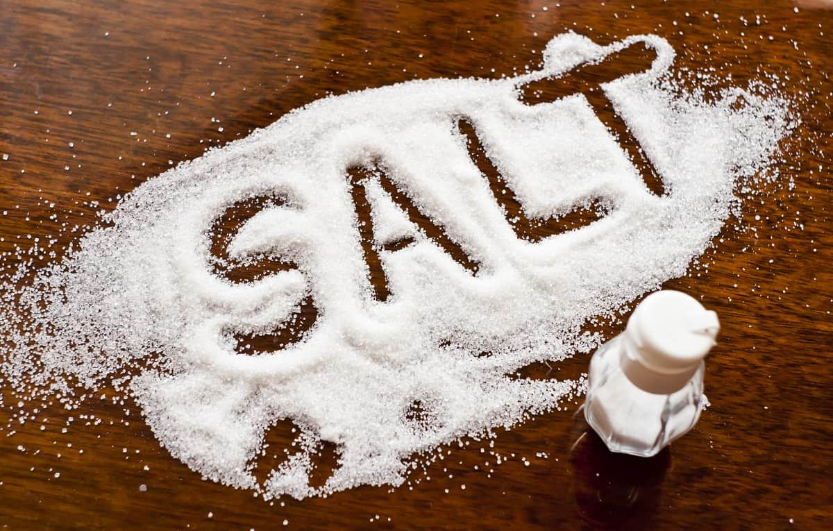 Salt written on counter in spilled salts
