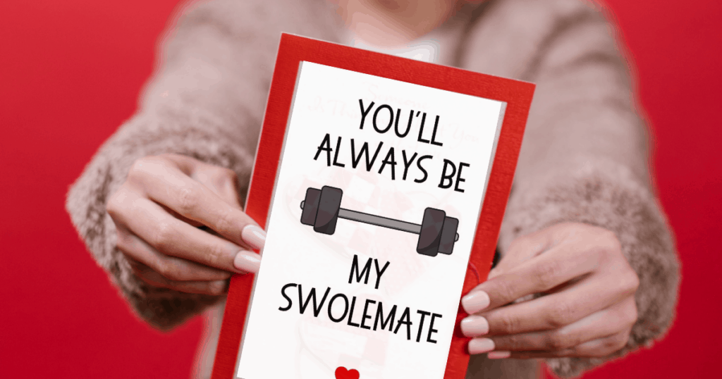 A woman holding a fitness Valentine's Day card with a red background.