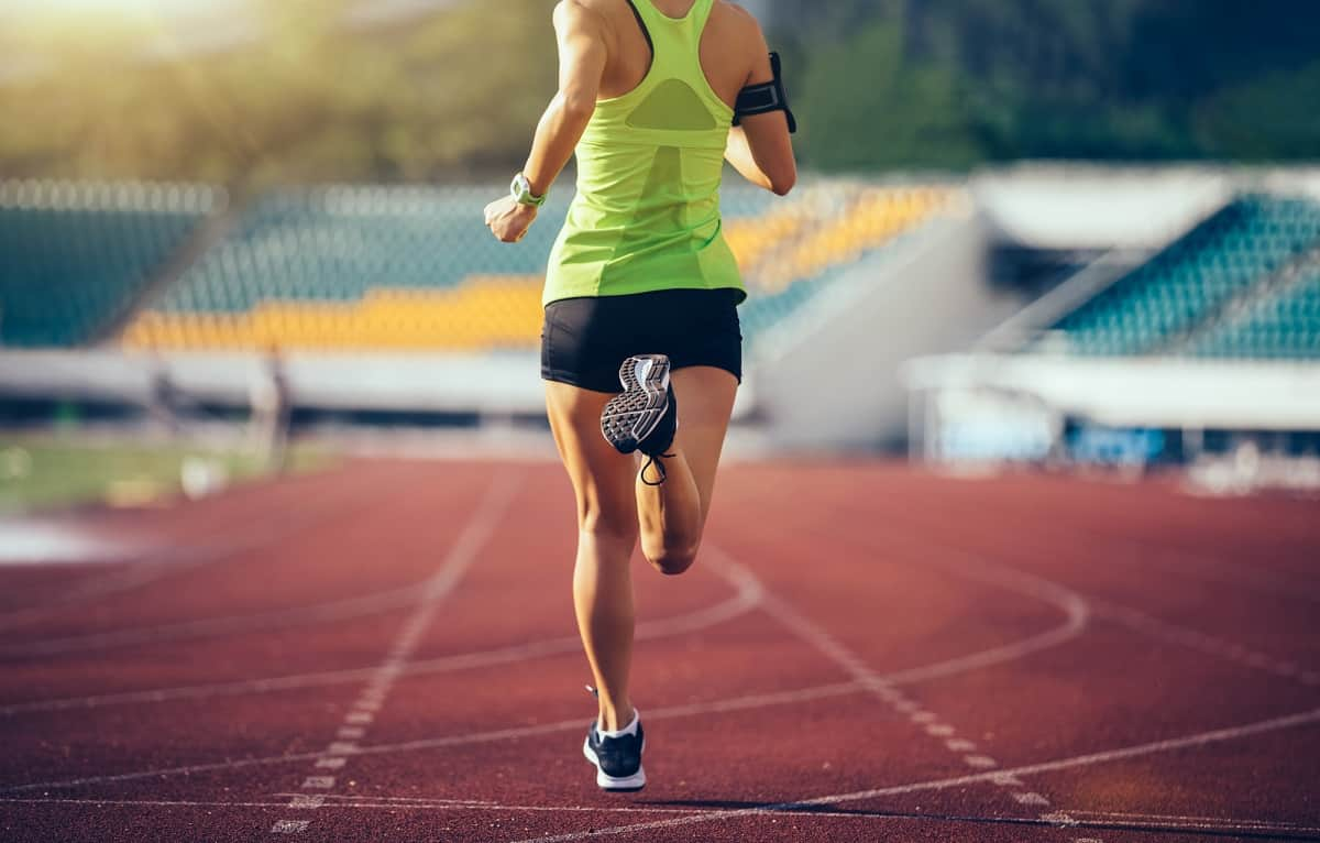 A woman running on a track.