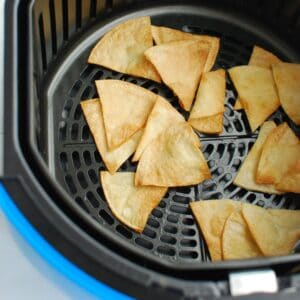 Air fryer tortilla chips after they were just cooked still in the air fryer basket.