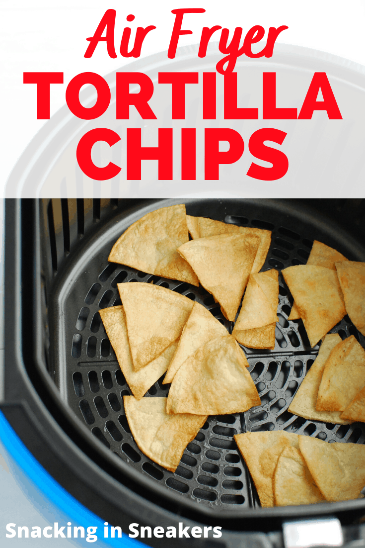 Air fryer tortilla chips in the air fryer basket with a text overlay.