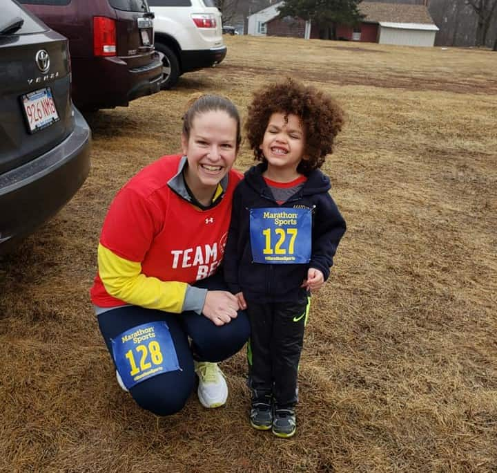 A child and his mom getting ready to run a 5K.