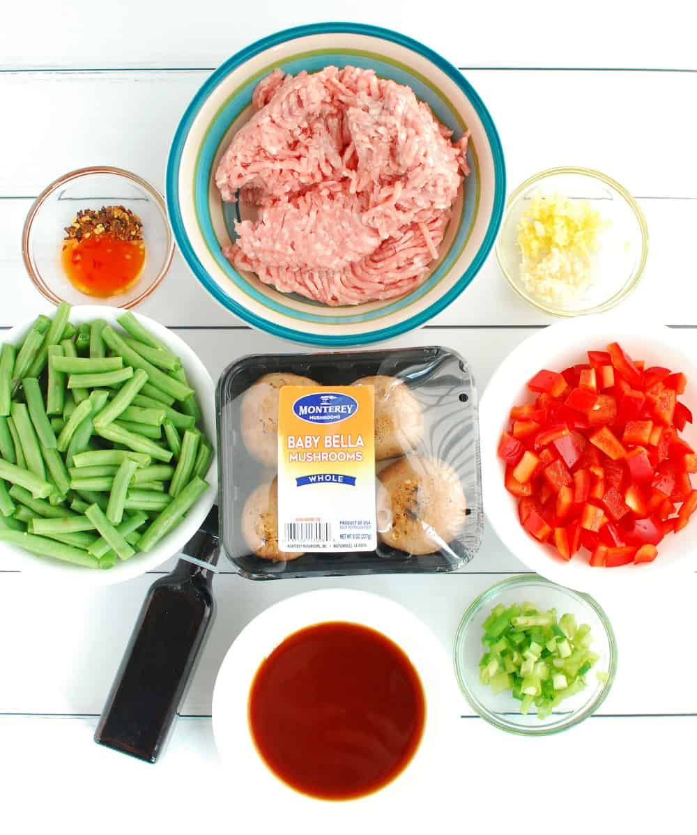 All of the ingredients to make the stir fry on a white backdrop.