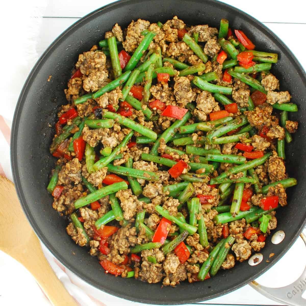Ground pork stir fry in a large skillet.