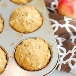Apple cheddar muffins baked in a pan.