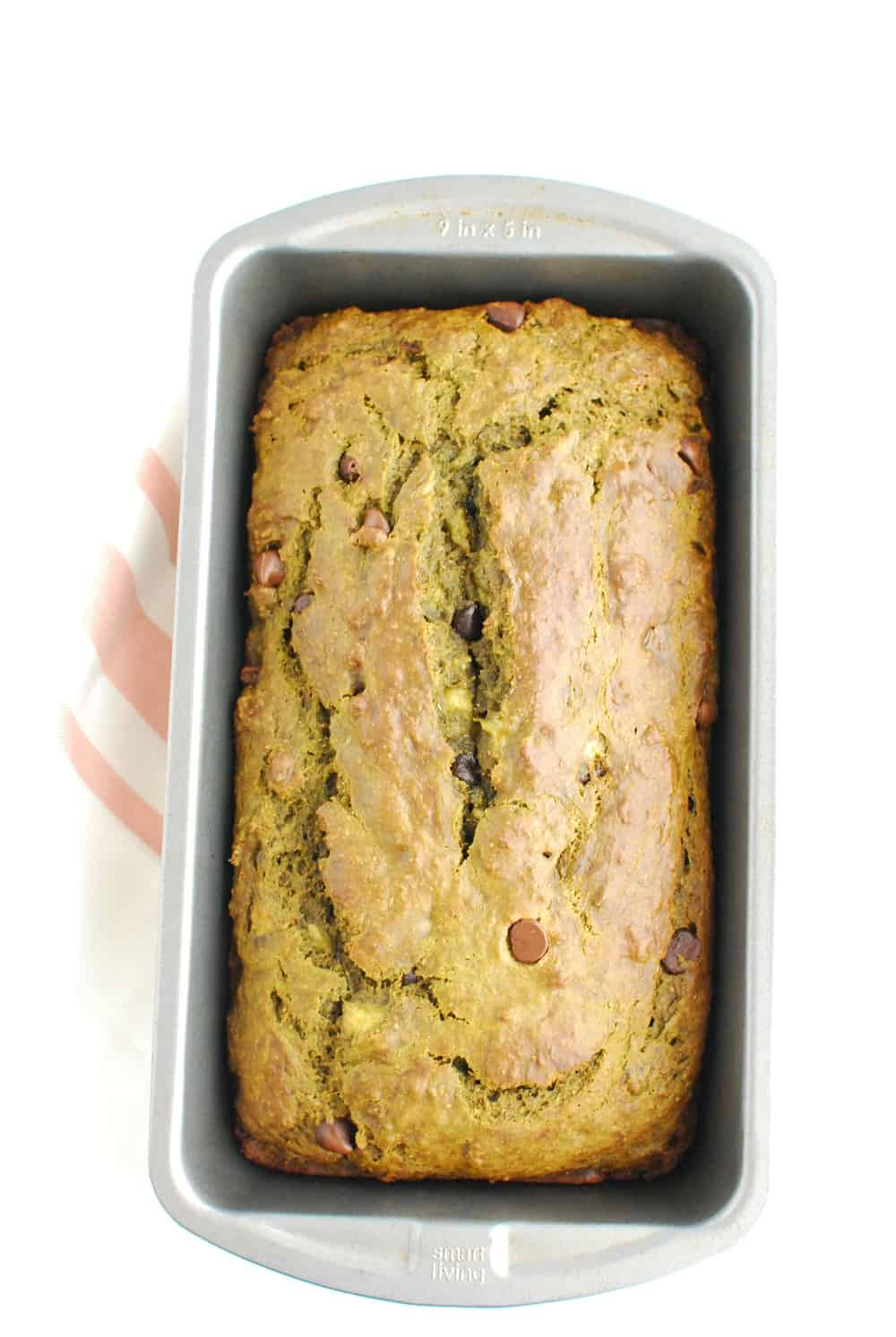 A loaf pan with cooked banana bread.