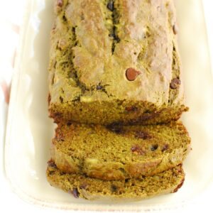 A close up of two slices of matcha banana bread that were cut from the loaf on a plate.