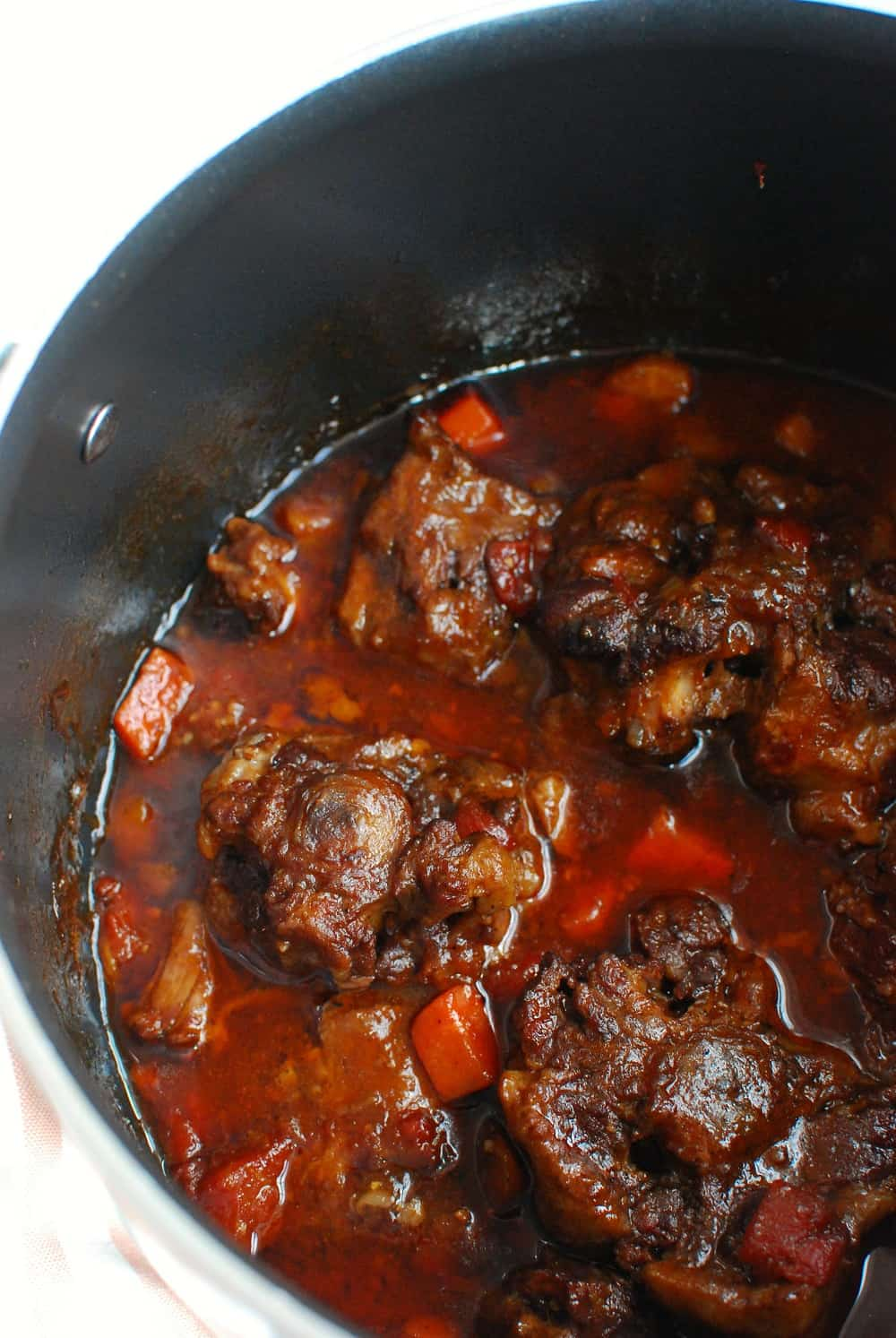 Braised oxtail in a pot at the end of cooking.