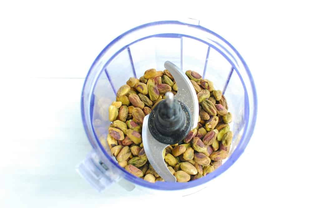 Shelled pistachios in a small food processor.