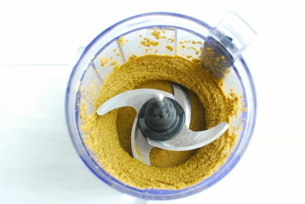 Homemade pistachio butter in a small food processor.