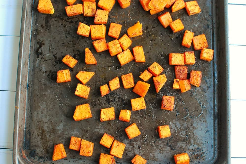 A sheet pan with roasted butternut squash.