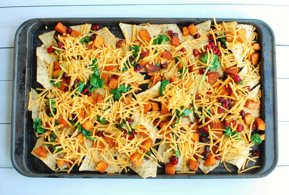 Sheet pan nachos before cooking in the oven.