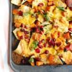 Close up of a sheet pan full of butternut squash nachos.