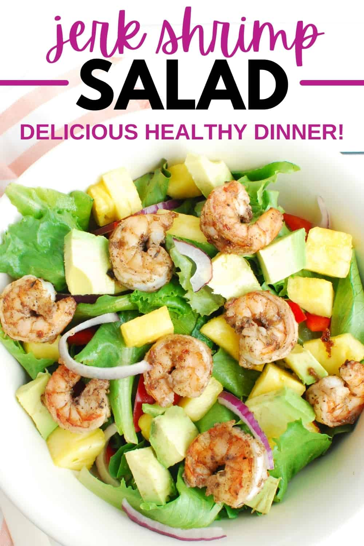 An overhead shot of a bowl of jerk shrimp salad.