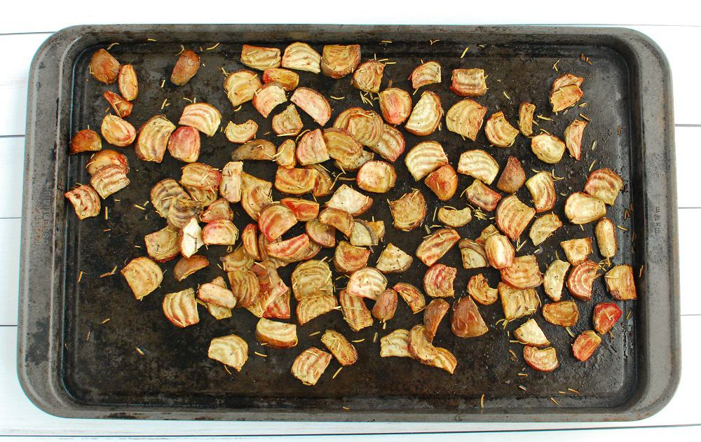 Roasted chioggia beets on a baking sheet after cooking.