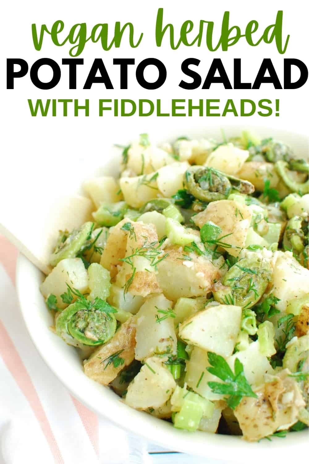 A bowl of healthy herbed potato salad with a wooden spoon, and a text overlay for Pinterest.
