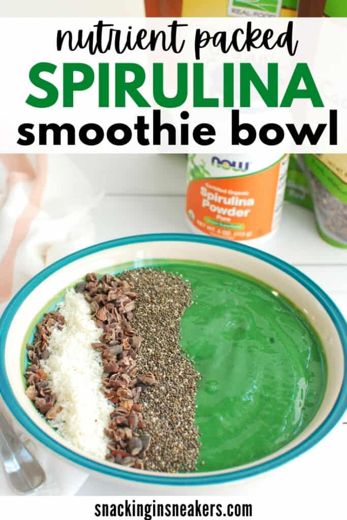 A spirulina smoothie bowl topped with chia seeds, coconut, and cacao nibs.